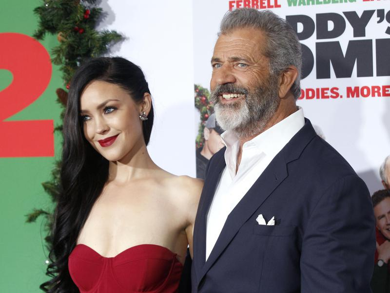 "Rosalind Ross, left, and Mel Gibson arrive at the LA Premiere of ""Daddy's Home 2"" at the Regency Village Theatre on Nov. 5, 2017, in Los Angeles."