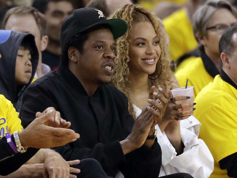 Jay-Z and Beyonce watch Game 1 of an NBA basketball second-round playoff series between the Golden State Warriors and the New Orleans Pelicans on April 28, 2018, in Oakland, Calif.