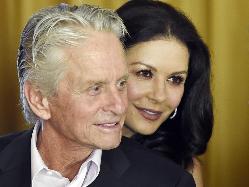 In this Dec. 9. 2016, photo, actor Michael Douglas and his wife, actress Catherine Zeta-Jones, attend a party at the Beverly Hills Hotel in Beverly Hills, Calif.