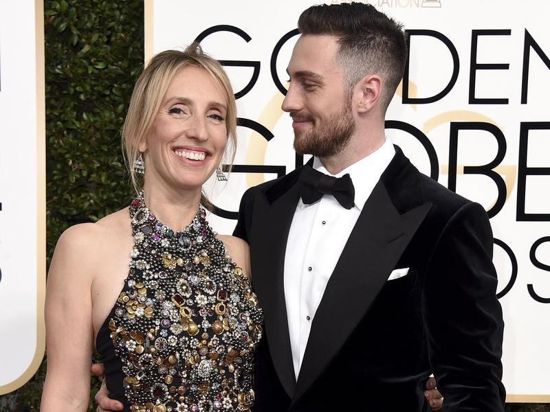 Sam Taylor-Johnson, left, and Aaron Taylor-Johnson arrive at the 74th annual Golden Globe Awards at the Beverly Hilton Hotel on Jan. 8, 2017, in Beverly Hills, Calif.