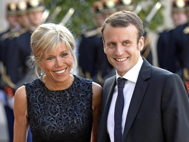 On June 2, 2015, Emmanuel Macron, left, and his wife Brigitte Macron pose for photographers as they arrive at the Elysee Palace in Paris.