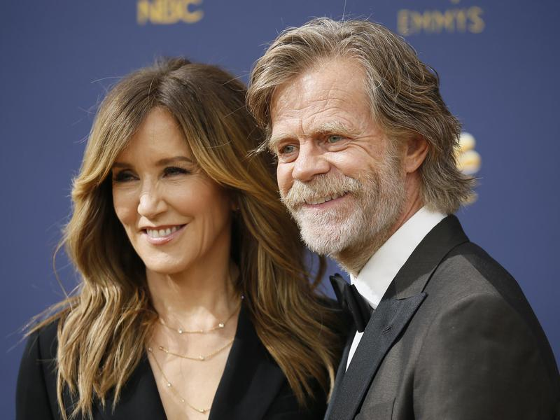 Felicity Huffman, left, and William H. Macy arrive at the 70th Primetime Emmy Awards on Sept. 17, 2018, at the Microsoft Theater in Los Angeles.