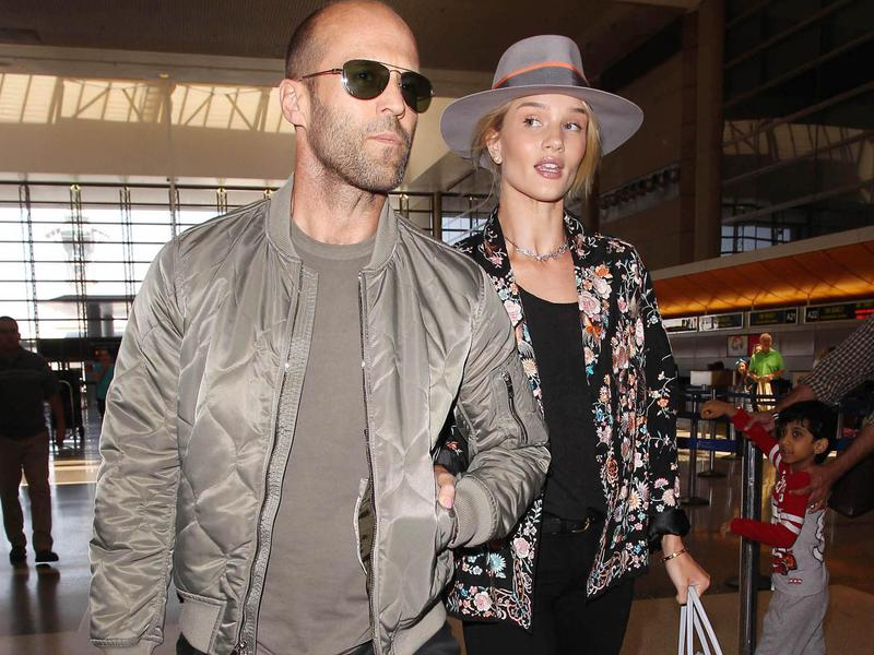 Jason Statham and Rosie Huntington-Whiteley walk together at LAX in Los Angeles on July, 23 2015.
