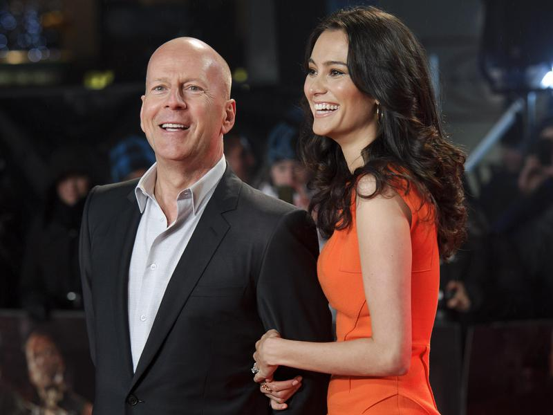 "In this Feb. 7, 2013 file photo, U.S. actor Bruce Willis, left, and British actress Emma Heming arrive for the British premiere of the film, ""A Good Day To Die Hard,"" at a central London cinema."