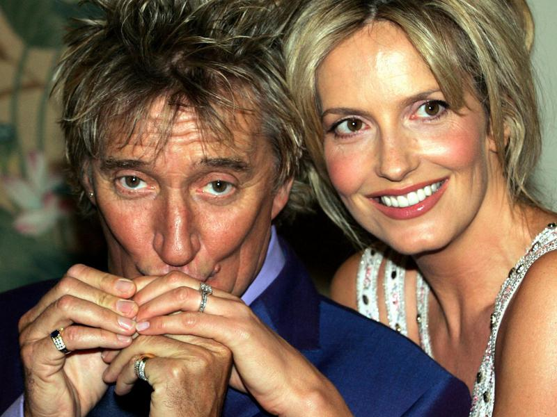 Rock star Rod Stewart, left, kisses the hand of model Penny Lancaster, after announcing that they are to marry, in central London March 12, 2005.