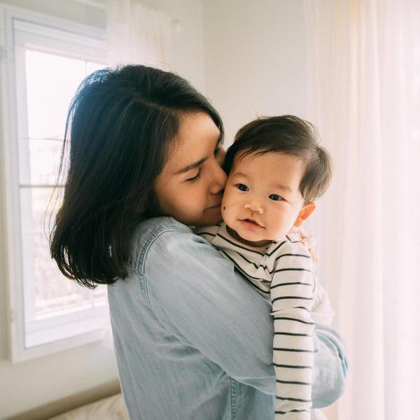 Asian Mother and Baby having fun at home, Bangkok, Thailand.