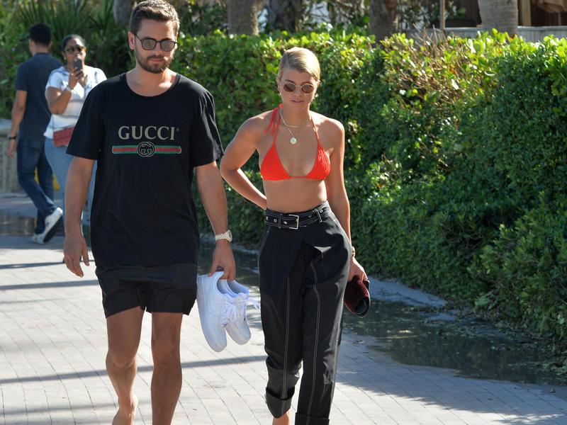Scott Disick, 34, holds hands and takes a romantic sunset walk with his new girlfriend Sofia Richie, 19, on September 23, 2017 in Miami Beach, Fla.
