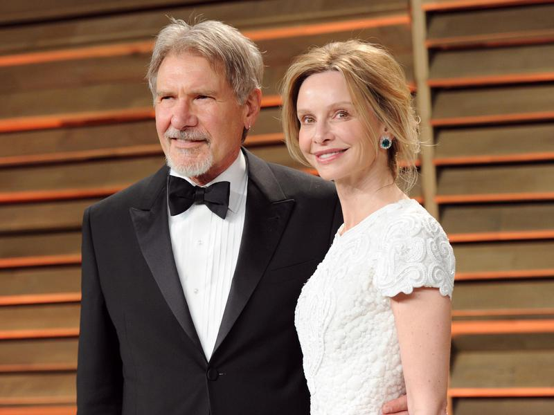 Harrison Ford, left, and Calista Flockhart attend the 2014 Vanity Fair Oscar Party on March 2, 2014, in West Hollywood, Calif.