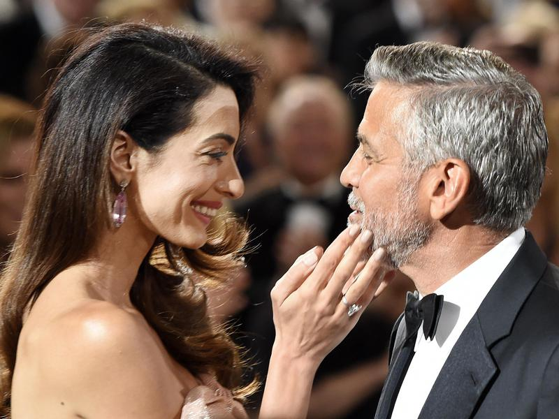 Actor/director George Clooney, right, is greeted by his wife Amal as he arrives in the ballroom at the 46th AFI Life Achievement Award gala honoring him at the Dolby Theatre on June 7, 2018, in Los Angeles.