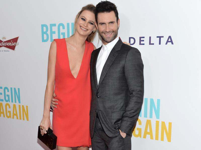 "Behati Prinsloo, lerft, and Adam Levine arrive at the New York premiere of ""Begin Again"" on June 25, 2014, in New York."
