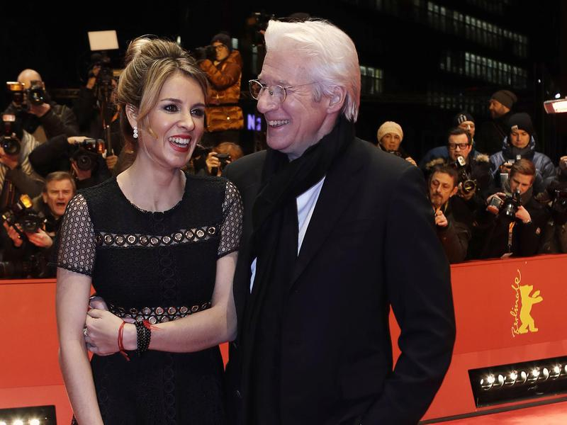 "Actor Richard Gere, right, and Alejandra Silva pose on the red carpet for the film ""The Dinner"" during the 2017 Berlinale Film Festival in Berlin, Germany, on Feb. 10, 2017."